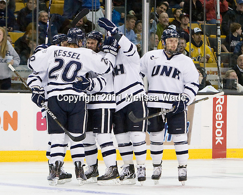 (Kostolansky), Blake Kessel (UNH - 20), Mike Sislo (UNH - 19), (DeSimone), Paul Thompson (UNH - 17) celebrate before officials ruled no goal following review. - The Merrimack College Warriors defeated the University of New Hampshire Wildcats 4-1 (EN) in their Hockey East Semi-Final on Friday, March 18, 2011, at TD Garden in Boston, Massachusetts.
