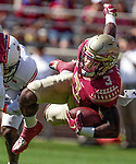 Florida State running back Cam Akers gets upended by vNorthern Illinois University on September 22, 2018 in Tallahassee, Florida.  The Seminoles defeated the Huskies 37-19.