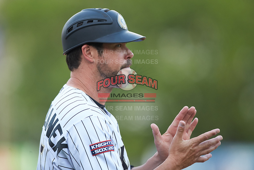 Charlotte Knights manager Mark Grudzielanek (15) coaches third base during the game against the Indianapolis Indians at BB&T BallPark on May 26, 2018 in Charlotte, North Carolina. The Indians defeated the Knights 6-2.  (Brian Westerholt/Four Seam Images)