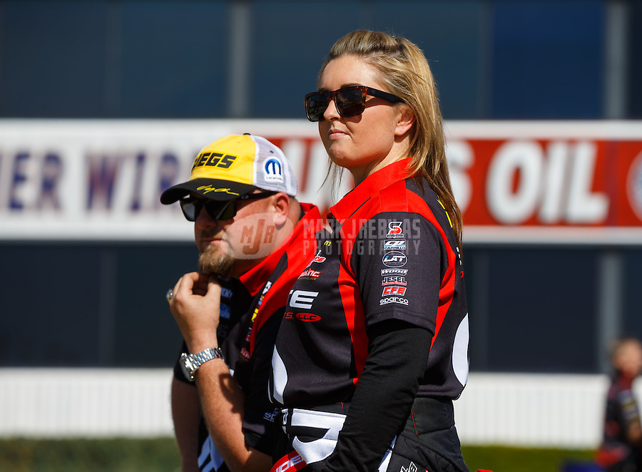 Feb 12, 2016; Pomona, CA, USA; NHRA pro stock driver Erica Enders-Stevens (right) and car owner Richard Freeman during qualifying for the Winternationals at Auto Club Raceway at Pomona. Mandatory Credit: Mark J. Rebilas-USA TODAY Sports