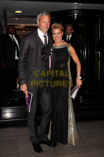 Mark Foster &amp; Natalie Lowe<br /> Pride of Britain Awards, Grosvenor House, London, England.<br /> 7th October, 2013<br /> full length black dress suit gold<br /> CAP/AH<br /> &copy;Adam Houghton/Capital Pictures