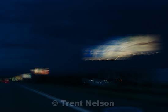Slow shutter exposures driving south on I-15, near Cedar City. billboards