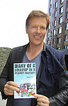 General Hospital Jack Wagner shows off Jane Elissa's book Diary of a Lollipop in a Peanut Factory with proceeds going to Leukemia (Photo by Sue Coflin/Max Photos)