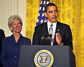 "Washington, D.C. - March 2, 2009 -- United States President Barack Obama, right, names Governor Kathleen Sebelius (Democrat of Kansas), left, as Secretary of the Department of Health and Human Services (HHS) in the East Room of the White House in Washington, DC on Monday, March 2, 2009.  The President also announced the release of $155 million authorized by the American Recovery and Reinvestment Act (ARRA) that will support 126 new health centers.  In a release, the White House stated ""These health centers will help people in need - many with no health insurance - obtain access to comprehensive primary and preventive health care services."".Credit: Ron Sachs / Pool via CNP"