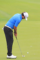 Brooks Koepka (USA) putts on the 3rd green during Thursday's Round 1 of the 2014 BMW Masters held at Lake Malaren, Shanghai, China 30th October 2014.<br /> Picture: Eoin Clarke www.golffile.ie