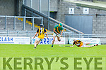 Kilmoyley's Kieran McCarthy about to shoot on goal as Stephen O'Sullivan of  Abbeydorney bears down on him, in R2 of the Garvey Supervalu Hurling Championship on Sunday.