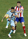 Atletico de Madrid's Jose Maria Gimenez (r) and Rayo Vallecano's Javier Ignacio Aquino during La Liga match.January 24,2015. (ALTERPHOTOS/Acero)