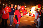 "Walkers participate in the 2010 ""Light the Night"" event in Rockville, Maryland.  Light the Night is an annual charity walk organized by the Leukemia & Lymphoma Society.  Each year, communities across the US and Canada join together to raise funds, bringing help and hope to people battling blood cancers.  Walkers carry illuminated white, red, and gold balloons as they walk.  White balloons designate survivors, red is for supporters, and gold balloons are in memory of loved ones lost to cancer.  Each walk usually brings 2,000 to 3,000 walkers, and pre-walk festivities are marked by live music and carnival games."