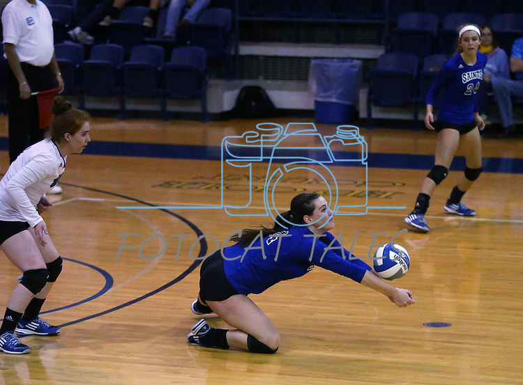 Marymount's Cassidie Watson and Emileigh Rettig watch Erin Allison get a dig in a college volleyball game against St. Mary's in Lexington Park, MD, on Wednesday, Oct. 29, 2014. Marymount won 3-2 to go 24-9 on the season.<br /> Photo by Cathleen Allison