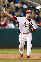 Zack Cox (7) of the Springfield Cardinals throws to first base during a game against the Northwest Arkansas Naturals at Hammons Field on August 1, 2011 in Springfield, Missouri. Springfield defeated Northwest Arkansas 7-1. (David Welker / Four Seam Images)