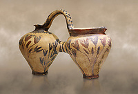 Minoan decorated double ewer with crocus flower  design,  Poros Heraklion 1800-1650 BC;  Heraklion Archaeological  Museum.