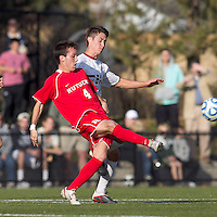 Rutgers University midfielder Nate Bourdeau (4) passes the ball as Boston College midfielder/defender Colin Murphy (21) defends. Rutgers University defeated Boston College in penalty kicks after two overtime periods in NCAA Division I tournament action, at Newton Campus Field, November 20, 2011.