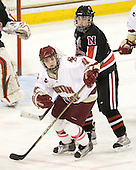 Melissa Bizzari (BC - 4), Julia Marty (NU - 16) - The Boston College Eagles defeated the visiting Northeastern University Huskies 2-1 on Sunday, January 30, 2011, at Conte Forum in Chestnut Hill, Massachusetts.
