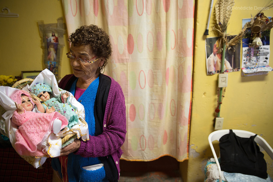 Marie Lou, a resident of Casa Xochiquetzal, holds her two Niño Dios (baby Jesus) in her bedroom at the shelter in Mexico City, Mexico on February 10, 2017. Casa Xochiquetzal is a shelter for elderly sex workers in Mexico City. It gives the women refuge, food, health services, a space to learn about their human rights and courses to help them rediscover their self-confidence and deal with traumatic aspects of their lives. Casa Xochiquetzal provides a space to age with dignity for a group of vulnerable women who are often invisible to society at large. It is the only such shelter existing in Latin America. Photo by Bénédicte Desrus