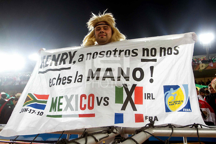 A fan of Mexico in the stands with a message of support for Ireland