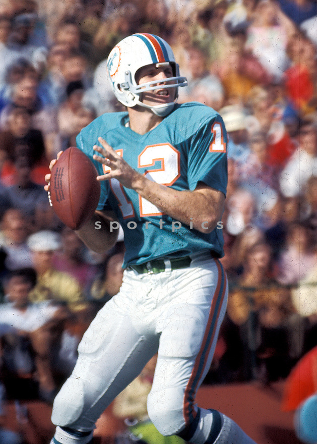 Miami Dolphins Bob Griese (12), in action during a game at the Miami Orange Bowl.  Bob Griese was inducted to the Pro Football Hall of Fame in 1990.