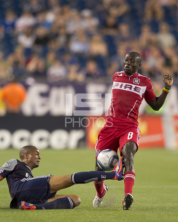 Sliding New England Revolution defender Darrius Barnes (25) intercepts pass to Chicago Fire forward Dominic Oduro (8). In a Major League Soccer (MLS) match, the New England Revolution tied the Chicago Fire, 1-1, at Gillette Stadium on June 18, 2011.