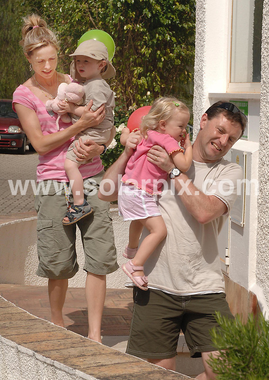 **ALL ROUND PICTURES FROM SOLARPIX.COM**.**WORLDWIDE SYNDICATION RIGHTS**.Gerry and Kate McCann whose 3 year old daughter, Madeleine, was abducted from their holiday apartment in the Algarve, Portugal, on Thursday May 3rd 2007. .Mum and Dad Gerry and Kate McCann with twins Sean and Amelia arrive back at  their apartment in Luz  after spending Madeline's Birthday away in a private Villa May 12th 2007, 9 days after Madeleine's disappearance...This pic: Kate and Gerry McCann..JOB REF: 4768 CSH        DATE: 12_05_2007.**MUST CREDIT SOLARPIX.COM OR DOUBLE FEE WILL BE CHARGED* *UNDER NO CIRCUMSTANCES IS THIS IMAGE TO BE REPRODUCED FOR ANY ONLINE EDITION WITHOUT PRIOR PERMISSION*