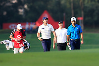 Rory McIlroy (NIR) Justin Rose (ENG) and Xander Schauffele (USA) walking down the 9th during round 1 at the WGC HSBC Champions, Sheshan Golf Club, Shanghai, China. 31/10/2019.<br /> Picture Fran Caffrey / Golffile.ie<br /> <br /> All photo usage must carry mandatory copyright credit (© Golffile | Fran Caffrey)