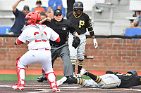 Johnson City catcher Irving Wilson (28) tags out a hard sliding Felix Vinicio as home plate umpire Josh Gilreath calls him out during a game against the Bristol Pirates at TVA Credit Union Ballpark on June 23, 2017 in Johnson City, Tennessee. The Pirates defeated the Cardinals 4-3. (Tony Farlow/Four Seam Images)