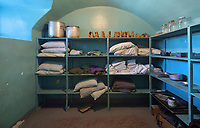 Storeroom housing sheets, pillows and boots, in the Vieille Prison de Trois Rivieres, or Old Prison, built 1816-22 in Palladian style by Francois Baillairge, and used as a jail 1822-1986, now the Quebec Museum of Popular Culture, in Trois-Rivieres, Mauricie, on the Chemin du Roi, Quebec, Canada. The Chemin du Roy or King's Highway is a historic road along the Saint Lawrence river built 1731-37, connecting communities between Quebec City and Montreal. Picture by Manuel Cohen
