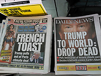 Headlines of New York newspapers on Friday, June 2, 2017 report on President Donald Trump withdrawing the U.S. from the Paris Climate Agreement. (© Richard B. Levine)