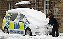 24/03/13 ..Police clear snow from their vehicles after heavy snowfall overnight in Bakewell, Derbyshire Peak District...All Rights Reserved - F Stop Press.  www.fstoppress.com. Tel: +44 (0)1335 300098.