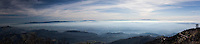 Multiple images from the summit of Mount Diablo have been combined to create a single panoramic image.  In the far right, a communications tower and the winding road up can be seen.