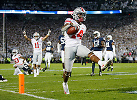 Ohio State Buckeyes wide receiver K.J. Hill Jr. (14) high steps into the endzone for a 24-yard touchdown during the fourth quarter of the NCAA football game against the Penn State Nittany Lions at Beaver Stadium in University Park, Pa. on Sept. 29, 2018. The Buckeyes won 27-26. [Adam Cairns / Dispatch]