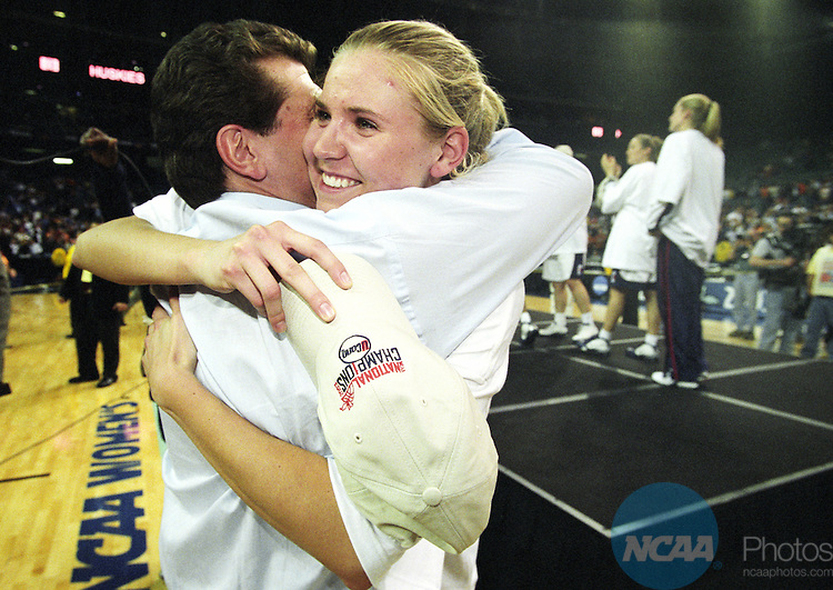 08 APR 2003:  Guard Ann Strother (43) and Head Coach Geno Auriemma of the University of Connecticut celebrate their victory over the University of Tennessee following the Division 1 Women's Basketball Championship held at the Georgia Dome in Atlanta, GA.  Connecticut defeated Tennessee 73-68 for the national title.  Jamie Schwaberow/NCAA Photos