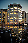 King's Place exhibition centre in London at night with reflections in the canal and moored barges