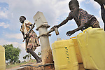 Children obtain water for their families from a well installed by the United Methodist Committee on Relief (UMCOR) in Yei, a town in Central Equatoria State in Southern Sudan. NOTE: In July 2011, Southern Sudan became the independent country of South Sudan