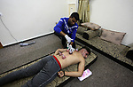 """A Palestinian specialist performs Hajima, also knows as """"wet cupping therapy"""", on a patient at his home, in Gaza city on October 16, 2019. Hijama is considered a traditional medical treatment in Islamic countries where blood is drawn by vacuum from a small skin incision for therapeutic purposes. Cupping therapy has been found in ancient records dating back 3500 years and is still used in Asian and Islamic countries like China, Pakistan, Iran and the Arab world. Photo by Mahmoud Ajjour"""