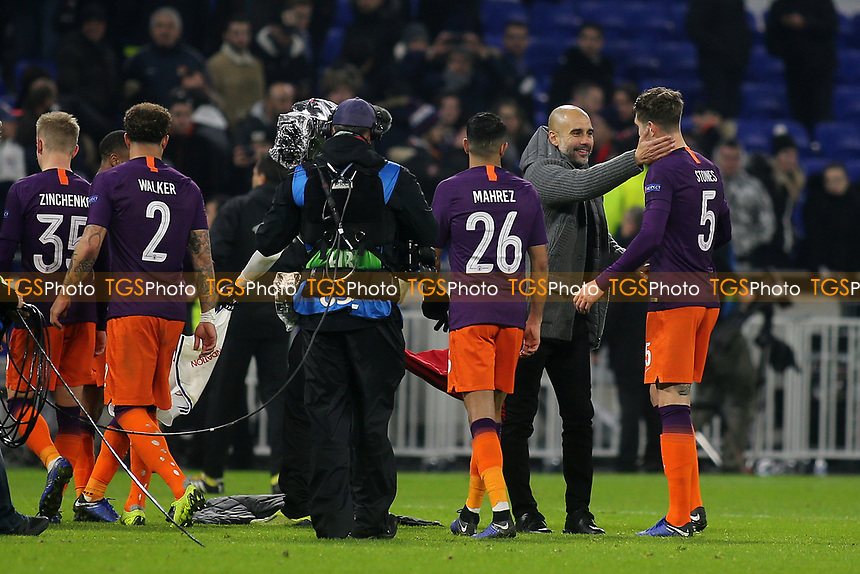 Manchester City Manager, Pep Guardiola shows his delight at the final whistle as he celebrates the draw with John Stones during Lyon vs Manchester City, UEFA Champions League Football at Groupama Stadium on 27th November 2018