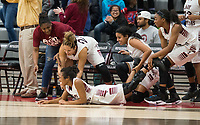 NWA Democrat-Gazette/BEN GOFF @NWABENGOFF<br /> Springdele players help up Thaly Sysavanh (3) after she fell on the court celebrating in the final seconds of the game against Bentonville West Friday, Jan. 12, 2018, in Bulldog Arena at Springdale High.