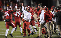NWA Media/ANDY SHUPE - Arkansas assistant coach Michael Smith high-fives with players against LSU during the third quarter Saturday, Nov. 15, 2014, at Razorback Stadium in Fayetteville.