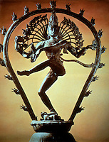 India:  Shiva, bronze, 10th Century. Both male and female, creator and destroyer; tramples demon of ignorance and forgetfulness. Flame-edged arch symbolizes this.