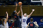 DURHAM, NC - DECEMBER 29: Duke's Erin Mathias (35) blocks a shot by Liberty's Keven Green (21). The Duke University Blue Devils hosted the Liberty University Flames on December 29, 2017 at Cameron Indoor Stadium in Durham, NC in a Division I women's college basketball game. Duke won the game 68-51.