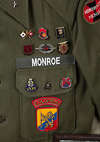 BNPS.co.uk (01202 558833)<br /> Pic: Julien'sAuctions/BNPS<br /> <br /> PICTURED: Marilyn Monroe's personalised army jacket  <br /> <br /> Marilyn Monroe's personalised army jacket and ID card have emerged for sale for £80,000. ($100,000)<br /> <br /> The starlet wore the green woollen jacket which is covered in army patches during her famous visit to entertain US troops in Korea in February 1954.<br /> <br /> The name 'Monroe' is in white stitching above the left pocket, and there are black and white photos of her posing in the long sleeved 'medium' sized jacket.<br /> <br /> Her 'Non Combatant's Certificate of Identity' card lists by her real name 'Norma Jeane DiMaggio' and there is a small photo of her in the top right hand corner of the laminated card, as well as her finger print.<br /> <br /> Monroe has signed it and a wealth of personal information is listed, including her date of birth, height, weight, hair colour and blood type. The items are being sold with Los Angeles based Julien's Auctions.