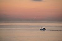 Fishing boat on calm summer evening twilight, Lofoten Islands, Norway