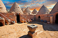 "Pictures of the beehive adobe buildings of Harran, south west Anatolia, Turkey.  Harran was a major ancient city in Upper Mesopotamia whose site is near the modern village of Altınbaşak, Turkey, 24 miles (44 kilometers) southeast of Şanlıurfa. The location is in a district of Şanlıurfa Province that is also named ""Harran"". Harran is famous for its traditional 'beehive' adobe houses, constructed entirely without wood. The design of these makes them cool inside. 24"
