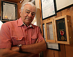 COCOA BEACH, FL - NOVEMBER 26, 2007: Al Neuharth, founder of USA Today and the Freedom Forum, poses for a photo next to his Bronze Star Medal in his office of his home in Cocoa Beach, FL. (Photo by Dave Eggen/Inertia/Freedom Forum)
