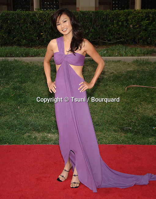 Michelle Krusiec  arriving at the AZN Asian Excellence Awards 2007 at the Royce Hall in UCLA in Los Angeles.<br /> <br /> full length<br /> eye contact<br /> purple dress<br /> smile