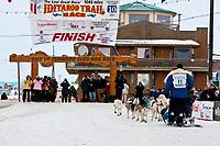 Musher Blake Freking runs down the finish chute in Nome during the 2010 Iditarod