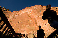 Tourists walk along the walls of the Fremont River canyon in Capitol Reef National Park, Wednesday, Oct. 22, 2008. The canyon walls feature many finely detailed petroglyphs carved by Fremont Indians centuries earlier.