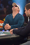 Hand #1 at final table:  Michael Perry goes all in, celebrates hitting his card, then reacts to the suck out as E.G. Harvin eliminates him from the tournament.