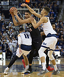 San Diego State forward Nolan Narain (24) is traped by Nevada forward Cody Martin (11) and forward Trey Porter (15) in the second half of an NCAA college basketball game in Reno, Nev., Saturday, March 9, 2019. (AP Photo/Tom R. Smedes)