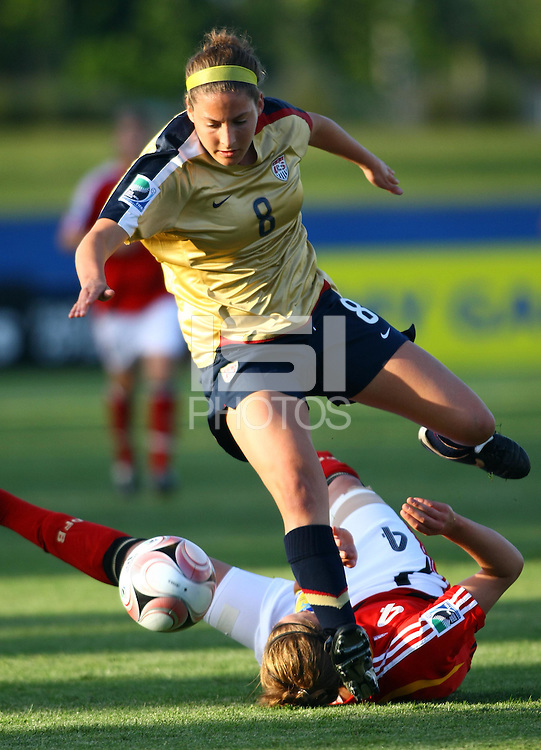 Vicki DiMartino (USA) jumps over Valeria Kleiner (GER) to take possession of the ball..FIFA U17 Women's World Cup, Semi Final, Germany v USA, QEII Stadium, Christchurch, New Zealand, Thursday 13 November 2008. Photo: Renee McKay/PHOTOSPORT