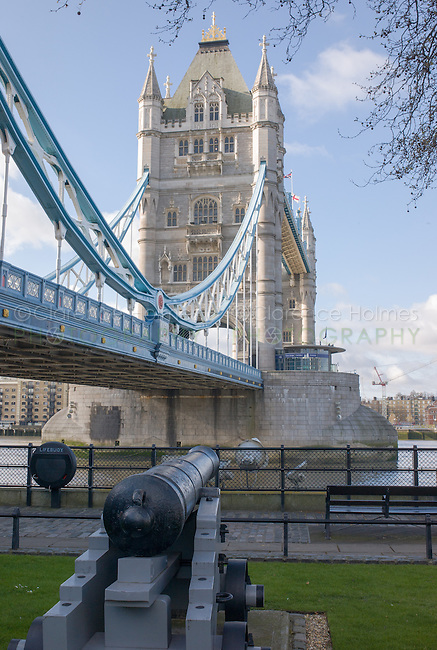 Tower Bridge and cannon from the grounds of the Tower of London, London, England