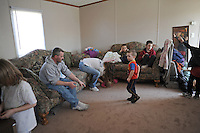 "Terry and Desiree Gonyon with six of their nine children (left-right) Aedily, 7, Haylee, 1, Tylar, 7, Zachary, 3, Michael, 9, and Kyle, 6, at home in a self-described combined household ""like the Brady Bunch,"" after they lost their home in nearby Elkhart, Indiana to foreclosure in the Timber Brook Mobile Home Park in Bristol, Indiana on April 8, 2009.  Two children were in Indianapolis for the day with relatives and friends and the oldest went to live with her mother."
